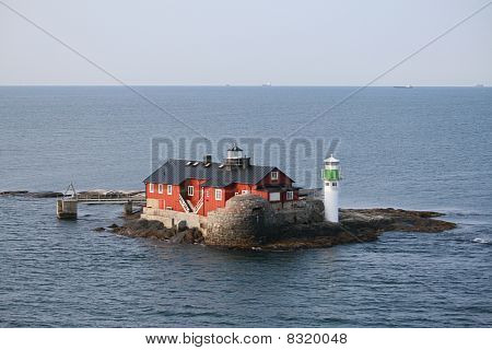 Island with house and lighthouse