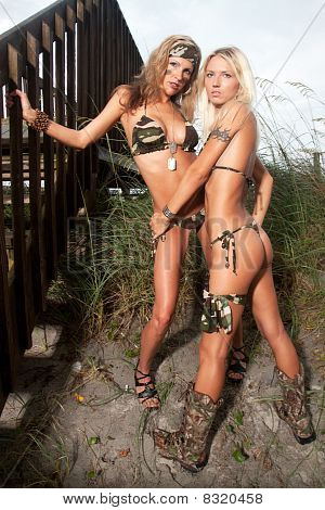 Two Female Models In Camo Green Bikinis In The Sand