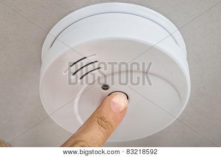 Finger Testing Smoke Detector
