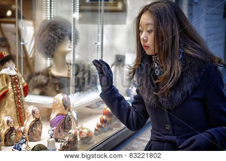 Real Photo Asian girl near funiture shop