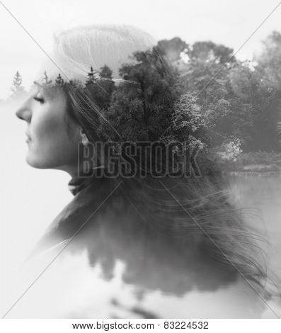 double exposure of young female and the forest near the lake(tilt-shift lens)