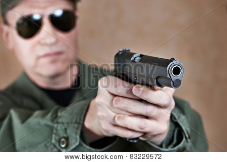 American Soldier Aiming A Pistol