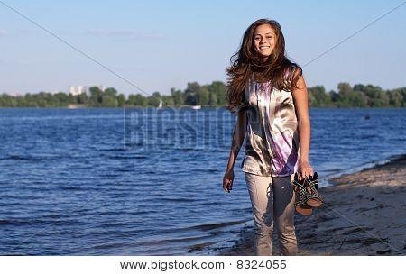 Happy Barefoot Girl On The Beach