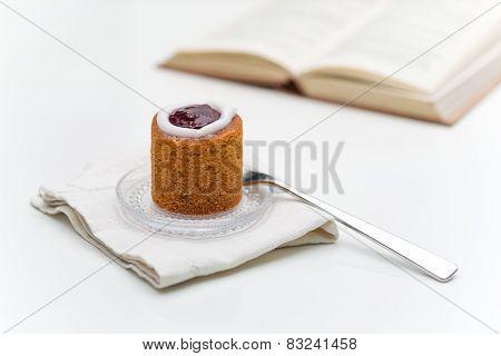 Runeberg Torte On Plate Next To Book