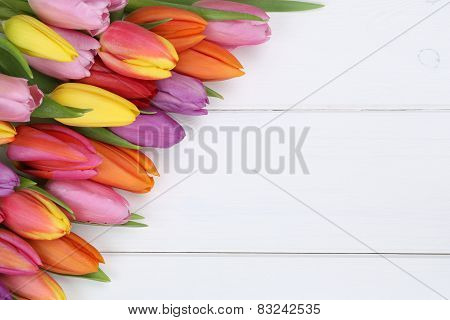 Tulips Flowers In Spring Or Mother's Day On Wooden Board