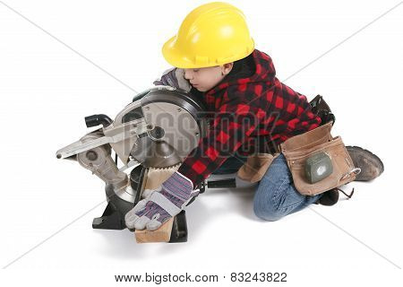 Young boy pretending to be a carpenter poster