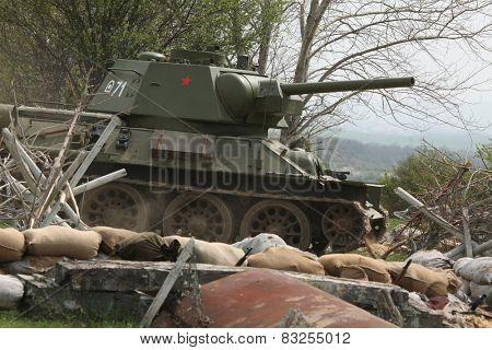 ORECHOV, CZECH REPUBLIC - APRIL 27, 2013: Re-enactors dressed as Soviet soldiers and a Soviet tank T-34 stage an attack during re-enactment of the Battle at Orechov (1945) near Brno, Czech Republic.