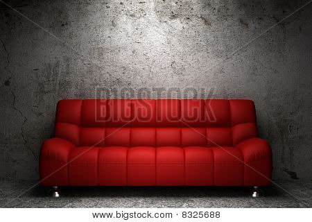 red leather sofa in front of grunge concrete wall