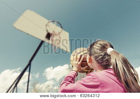 Girl shooting the ball in the basket