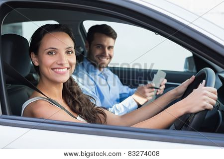 Young woman getting a driving lesson in the car