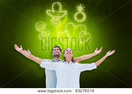 Cute couple standing with arms out against green background with vignette