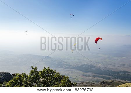Paragliding high above mountain range