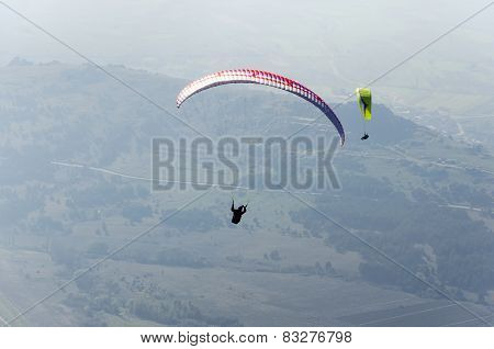 Paragliders flying high above the mountain range