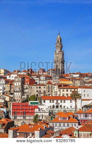 The iconic Clerigos Tower in the city of Porto, Portugal. One of the landmarks and symbols of the city, standing out from the city rooftops. Unesco World Heritage Site