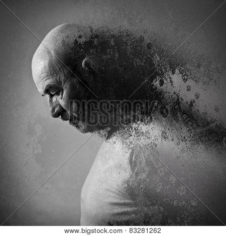 An old man with a grey beard in sorrow