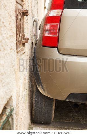 Car Parked Very Close To Wall