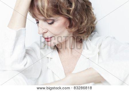 A sad portrait of senior woman in studio