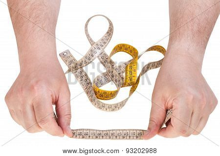 Male Hands With Sartorial Measuring Tape
