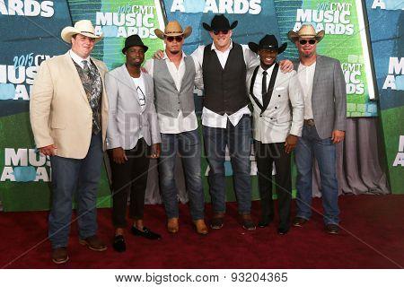 NASHVILLE, TN-JUN 10: NFL player JJ Watt (C) attends the 2015 CMT Music Awards at the Bridgestone Arena on June 10, 2015 in Nashville, Tennessee.