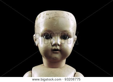 Vintage doll face isolated on black with clipping path