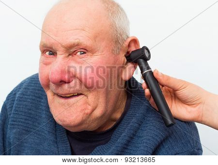 Testing Elderly Patient's Hearing With Auroscope