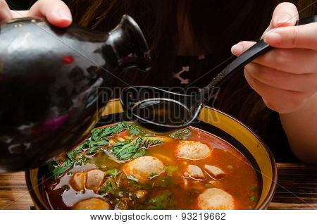 Pouring Wine Into A Bowl Of Chinese Noodle