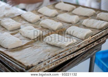 Metal Trays Of Fresh Ciabatta Bread Dough