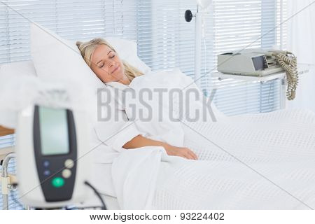 Happy patient lying on her bed in hospital