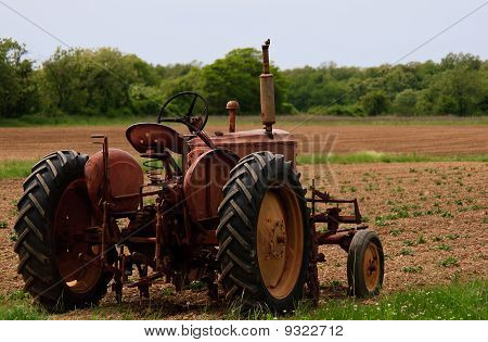 Old Farm Tractor In The Field