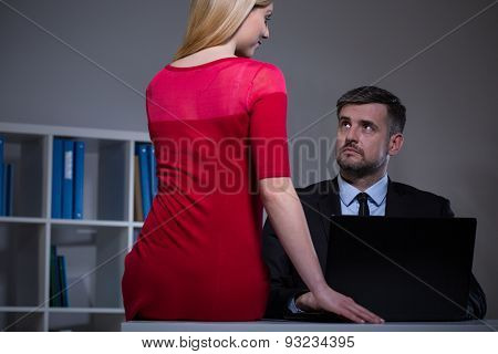 Attractive secretary seducing her boss in office poster