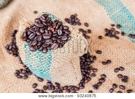 Coffee Beans In Coffee Bag On Sack Surface