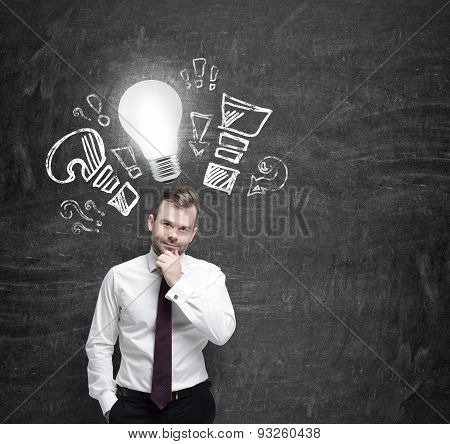 Young Manager Ponders About New Business Ideas. A Light Bulb As A Concept Of New Ideas.