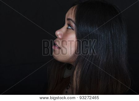 Young Asian Woman Gazing Into The Distance