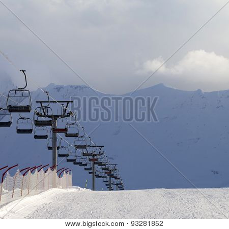Snow Skiing Piste And Ropeway At Evening