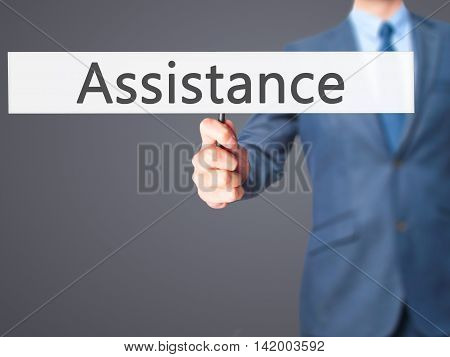 Assistance  - Business Man Showing Sign