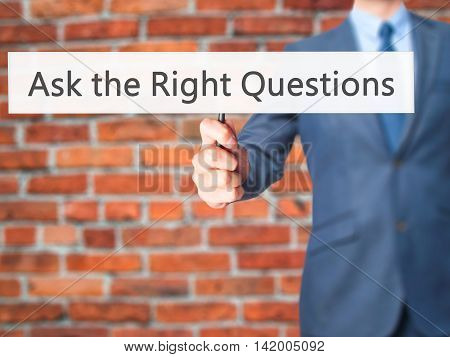 Ask The Right Questions - Business Man Showing Sign
