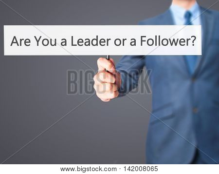Are You A Leader Or A Follower ? - Business Man Showing Sign