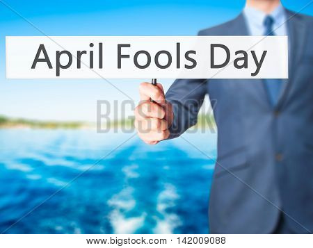April Fools Day - Business Man Showing Sign