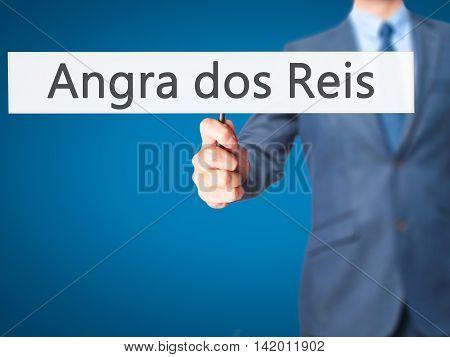 Angra Dos Reis - Business Man Showing Sign