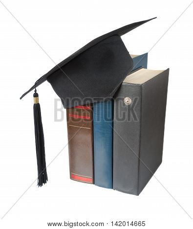Black graduate hat and big books isolated on white background
