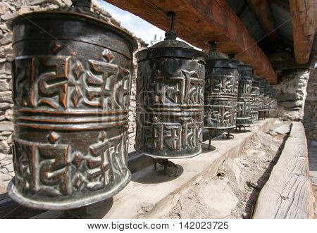 view of Buddhist many prayer wheels in Nepal
