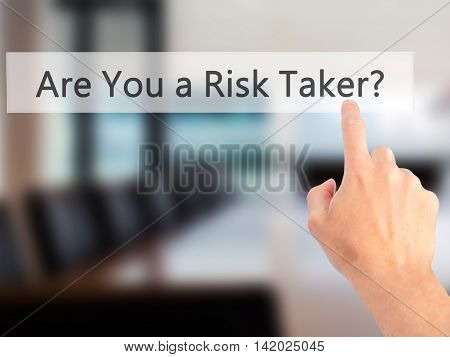 Are You A Risk Taker ? - Hand Pressing A Button On Blurred Background Concept On Visual Screen.