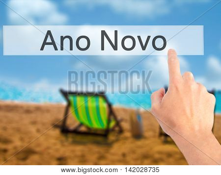 Ano Novo (new Year) - Hand Pressing A Button On Blurred Background Concept On Visual Screen.