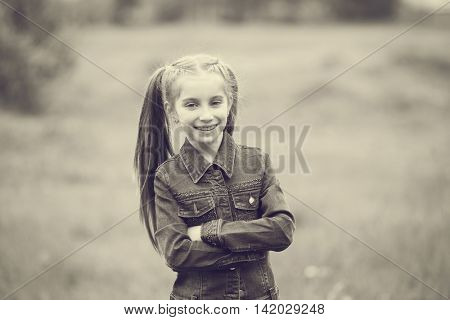 lovely smiling little girl with two tails closeup, black and white photo