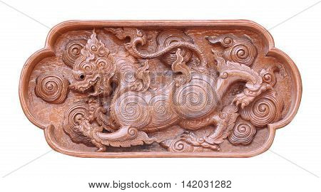 Wood carvings on the wall of Temple in Thailand; thai art style; Traditional Thai style wood carving on the wall of Temple in Thailand
