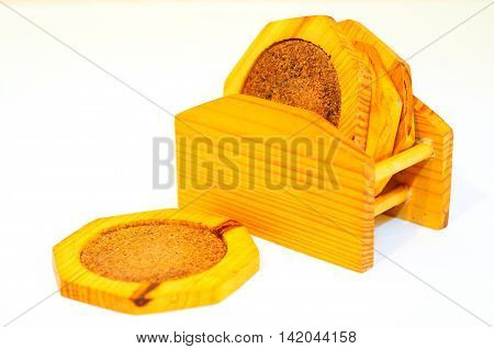 Set of wooden trivets isolated on white background.