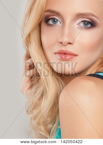 Beautiful natural woman with fashion make-up and blonde hair, portrait of  young girl isolated on white