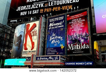 New York City - November 15 2015: Billboards advertising hit Broadway musicals Kinky Boots An American in Paris and Matilda in Times Square *