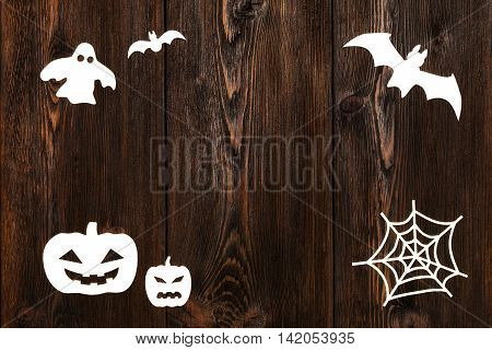 Paper haloween figures on wooden background with copy space. Abstract conceptual image