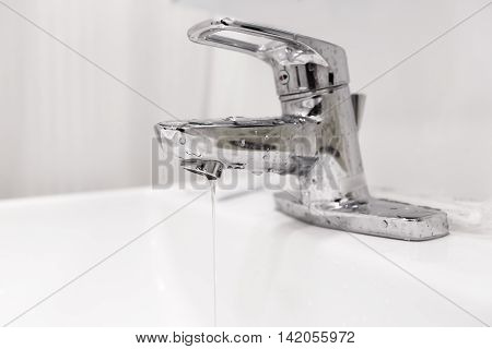 Bathroom water faucet with water leak running